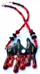 Necklace with townhouse glass pendant in red and orange with coral and onyx beads with sterling silver