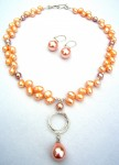 Pearl necklace and earrings in orange