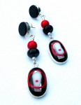 Dangling sterling silver earrings with onyx and coral beads and a fused-glass pendant