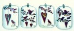 Fused-glass Valentine's Day decorations of birds and hearts hanging from twigs