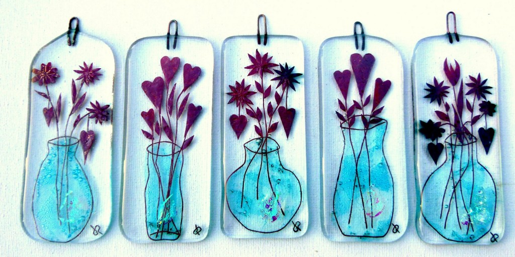 Fused-glass decorations with vase with flowers and hearts