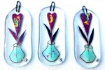 Fused-glass decorations with vase with a single heart flower