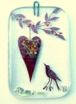 Fused-glass Valentine's Day decoration of a hanging heart and a chirping bird
