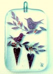 Fused-glass Valentine's Day decoration of two perched birds and two hearts hanging from twigs