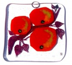 Glass art decoration with red apples