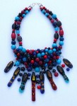 Necklace with multiple townhouse pendants with beads weaved on a wire mesh using turquoise,blue jade, coral and sterling silver