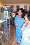 Visitors examing the display