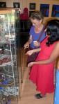 More visitors examining the display