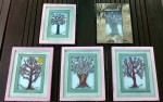 Five fused glass trees framed