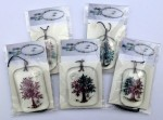 Five fused glass trees with fruit and moon packaged