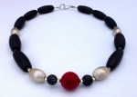 Necklace with black agate, sterling silver beads and a red coral centre