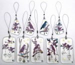 Fused-glass bird decorations