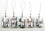 Fused-glass reindeer in snowy forest decorations