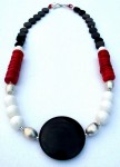 Necklace with hand-made sterling silver beads, onyx, coral, and onyx pendant