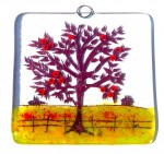 Glass decoration of red apple tree in farmer's field