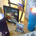 smller picture of framed glass art with surroundings